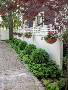 The property's landscaped driveway welcomes visitors on foot, by car, or even by horse (since Oldwick is situated in the heart of New Jersey's horse country with both the United States Equestrian Team headquarters and historic Essex Foxhounds nearby) with its drystone walls, antique Belgian block cobblestones, and pea gravel parking area.