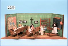 One-piece German doll room with original wallpaper furnished as a school, 67 cm wide (front), 50 cm wide (back) 24.5 cm high.   School desks protrude slightly beyond the housing.  Includes teacher's desk, wall map abacus on stand, black board, hanging crucifix and globe with stand.  Date not given.