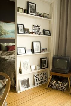 Great divider for bedroom. Seems less cluttered than bookshelves and more homey with pics of loved ones