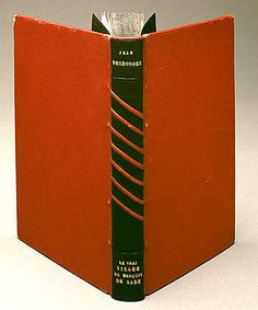 Binding by Mary Reynolds. Le Vrai visage du Marquis de Sade (The True Face of the Marquis de Sade) by Jean Desbordes. 1939. Red morocco goatskin, black calfskin, & gold stamping. Reynolds coyly alluded to Sade's salient characteristic by placing binding in bondage. Black calfskin-covered boards suggest darkness & perversion of Sade's erotic ideals. Red morocco diagonal bands tie up the book and suggest welts that result from some of Sade's favored activities.