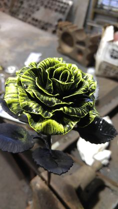"""Pushing the limit"" a painted and forged steel rose"