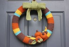Crocheted Fall Wreath - part of a fantastic roundup of free crochet Thanksgiving patterns on mooglyblog.com