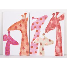This cute wall art from Cotton Tale adds a warm and inviting touch to baby's nursery. The Sundance art set features two canvas panels with adorable hand-painted giraffe silhouettes in shades of pink, orange, grey and cream.