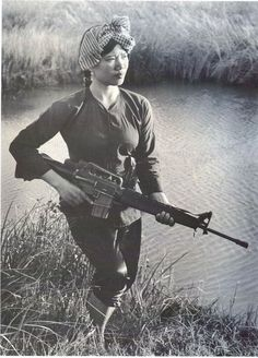 """Gook sniper, known as """"Apache"""" a VC Sniper with a captured M-16. She was Killed by Marine Sniper, Carlos Hathcock aka """"White Feather"""" Captured Her rifle. 1 of his 93 (confirmed) kills. Actual Total enemy KIA by Hathcock is estimated between 300 - 400 kills serving 2 tours in Vietnam. When working w/o a spotter, Listed in his journals & notepads. see; (wikipedia) Hathcock Served from 1959 - 1979"""