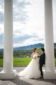 Summer morning wedding, The Manor House, Littleton, Colorado, Mountain view, Bride and groom against pillar, white rose floral bouquet