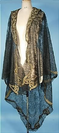 """c. 1910-1914 Black Chantilly Lace Evening Wrap Cape Trimmed in Gold Bullion Lace and Tassels! One of the MOST Extraordinary Shawls! It's possible that the black Chantilly lace used for this evening wrap cape is older... made from a mid-Victorian (c. 1865) shawl. According to the family history, this was worn during the """"Titanic"""" Edwardian era over a pale blue satin gown - probably to some fabulous event."""