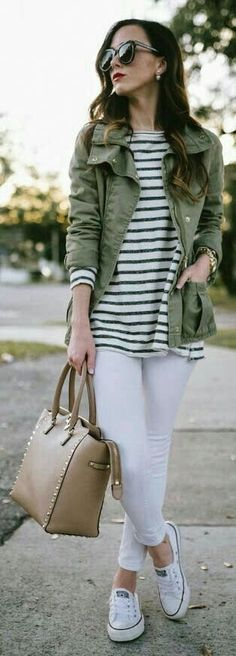 Khaki jacket with striped top and white jeans.