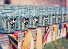 Mason jars with a bit of chalkboard paint with guests names on them for escort cards....so cute