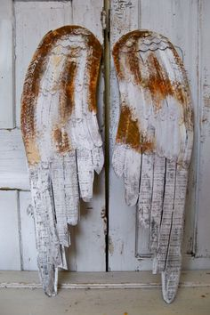 Large white rusty wings wooden metal wall sculpture distressed hand carved home decor Anita Spero. $195.00, via Etsy.