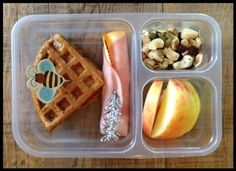 Whole-wheat waffle and cream cheese sandwich, an organic ham/cheese roll up (once in a blue moon I buy Applegate organic sandwich meat just to switch things up), some apple slices, and a homemade trail mix (nuts/seeds/raisins)