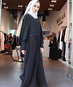 Wearing the black cape maxi from @inayahc