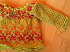 I have used solid green and red/yellow Kauni.