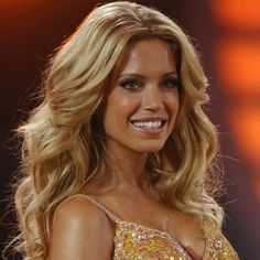 well idk who she is but shes beautiful. Sylvie van der vaart?