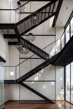 Interior Design Magazine: The focal point of this Bangkok residence by Stu/D/O Architects is an expansive vertical space—four . Architecture Design, Stairs Architecture, Spiral Staircase, Staircase Design, White Staircase, Stair Design, Stairway Lighting, Escalier Design, Stair Handrail