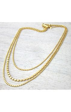 Shlomit Ofir Triple Disc Necklace in 24K Plated Gold.   http://www.shopcloakroom.com/collections/jewelry/products/triple-disc-necklace