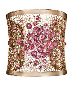 Pink Sapphire and Diamond Wide Cuff  Open-work rose gold cuff, with pink sapphires and round brilliant-cut diamonds interspersed throughout. 18-karat rose gold. Cellini Jewelers