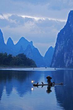 Dawn fisherman. © Graeme  Chow