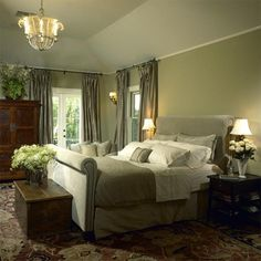 The sage green is very restful, & the rug gives a good pattern to the space, but it is crying out for art over the bed! That can make the difference between a room looking finished & unfinished, as you can see here.
