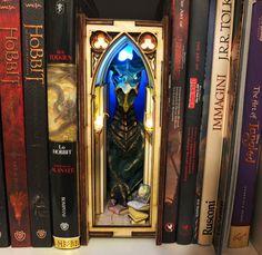#bookshelfinsert #diorama #booknook #dragon #library #ledlight Tardis Bookshelf, Bookshelves, Precious Book, 9 Volt Battery, Baby Dragon, White Lead, Book Nooks, Small World, Fantasy World