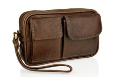 Leather Travel Pouch - has been made from a high grade of buffalo leather. Woody Brown colour. Timeless in style and colour and will age beautifully with use. 2 front pockets the first measuring 2.5 inches x 4 inches, the second measuring 4 inches which are velcro fastened. A single zip pocket which closes the pouch and directly behind this is a zip pocket. For ease of carrying there is a handheld strap on the left hand side of the pouch. Branded dustbag included.