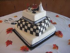Race car theme wedding cake. - She wanted the checkered flag effect on the middle tier. Chocolate cake/bavarian filling.