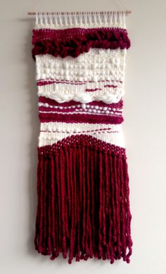 This striking hand woven wall hanging uses a variety of wool, roving and mixed yarn blends to create a piece that is irresistibly tactile. In rich burgundy and creams it is bold, yet subtle enough to suit most decors.  Measuring at 34cm wide and 84cm long including wooden rod.  Colours are true but please be aware that there may be differences between our monitor and yours.  Send a message to seller to ask about prices for international, express or registered post.