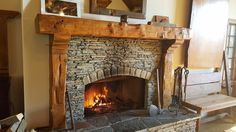 Vintage Timberworks of Rainbow, California has a plethora of ready, reclaimed mantels and corbels. This fireplace is on display in their factory showroom. Ashley Ludwig photo