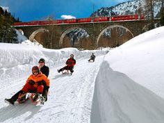 Sledding in Preda-Bergün, Switzerland.. Looks like so much fun!!