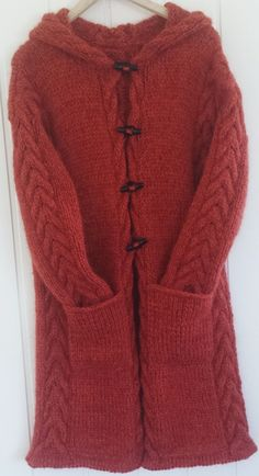 Pattern in Norwegian. Hand knitted jacket with hood, cable knit. Design Annelise Bjerkely