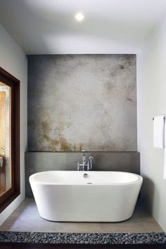 Love the finish on the wall and the river rock on the floor!