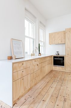 Flinders Lane Apartment / Clare Cousins Architects - love the brightness and blond wood. Needs colour of course...