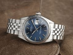 An Amazing vintage Rolex 1603 Datejust with blue Sigma dial and wide body indexes. Great condition and such a great mens style watch. Vintage wristwatch at its best. Rolex icon from 1969.