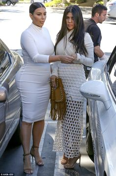 There's the bump! Kim Kardashian showed off her baby bump while hitting Casa Escobar in We...