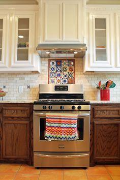 Spanish-style #kitchen design with saltillo #tile floors and Talavera/stone backsplash. #ideas
