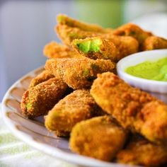 Deep fried avocado slices with cilantro lemon dipping sauce, the perfect pub food for St. Patrick's Day.