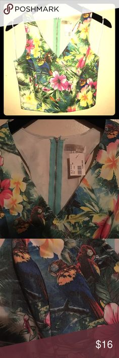 Jealous Tomato Tropical Print V neck Crop Top New denim blue and green with tropical print crop top. V neck with zippered back. Great fit, perfect for summer! 75% Cotton/22% Polyester/ 3% Spandex Jealous Tomato Tops Crop Tops