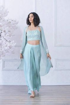 Inayah lengha kynah - high waisted dhoti skirt paired with a hand-embroidered crop top and long sleeves cape. Indian Bridal Fashion, Indian Wedding Outfits, Indian Outfits, Ethnic Outfits, Indian Gowns, Indian Attire, Indian Wear, Crop Top Designs, Blouse Designs