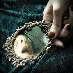 ...the mirror cracked from side to side...a curse has come upon me cried the Lady of Shalott