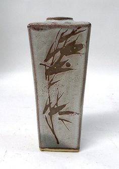 An interesting mid 20th century tapered slab form studio pottery vase with seal mark, in the manner of Shoji Hamada