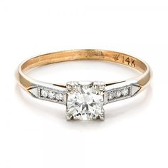 #100901 This estate two-tone gold engagement ring features a round center diamond and is accented by channel set diamonds on the sides. Circa 1940's.