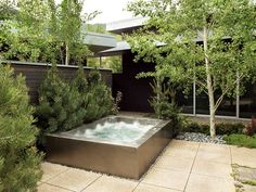 "Stainless Steel Spa with Bench Seating & LED Lighting. 70"" x 94""x 36"" (22"" skirt)"