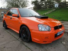 2003 Subaru Impreza 2.0 STI AWD saloon. 400 BHP. Orange. Service history. Click on pic shown for loads more.