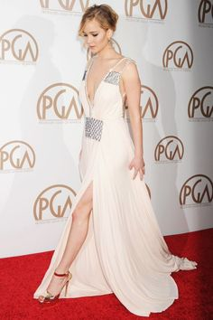 Jennifer Lawrence at the Producers Guild of America Awards A total goddess on the red carpet, Jennifer turned heads in this plunging Prada gown.