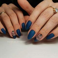 deep matte blue nail polish with nail art