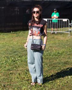 Denim trousers paired with a band tee.