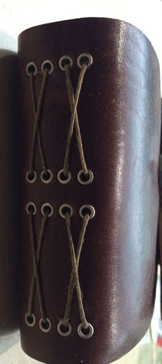 Side view eyelet set twine bound leather journal with hook clasp and craft signatures made by Sarah Behrens Lemon 4/15