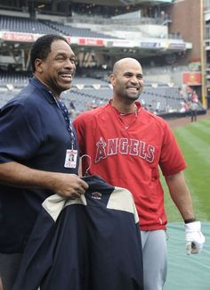 Game #40 5/18/12: Albert Pujols #5 of the Los Angeles Angels jokes with former San Diego Padres player Dave Winfield during batting practice before a baseball game against the San Diego Padres at Petco Park on May 18, 2012 in San Diego, California. (Photo by Denis Poroy/Getty Images)