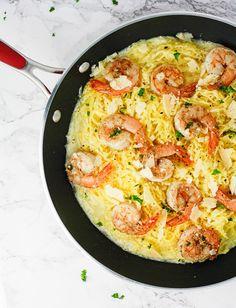Low carb Garlic Shrimp Spaghetti Squash coated in a creamy Greek Yogurt Alfredo sauce. Super easy, delicious and guilt free recipe!