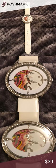 Ed hardy watch Very mild and pretty Ed Hardy Watch. White leather band. Stainless steel casing. Large numbers with crystals around face and on hands. Ed Hardy Jewelry