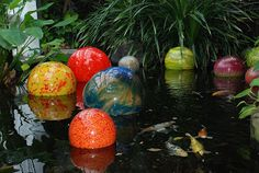 Floating glass orbs bring color to your water garden.